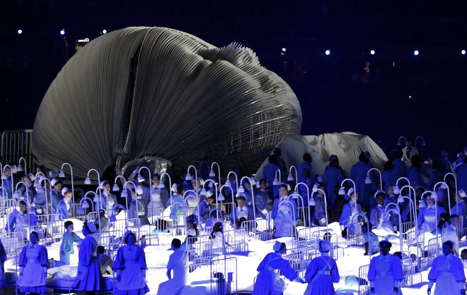 Actors perform in a sequence meant to represent Britain's National Health Service (NHS) perform during the Opening Ceremony at the 2012 Summer Olympics, Friday, July 27, 2012, in London.  (AP Photo/Jae C. Hong)