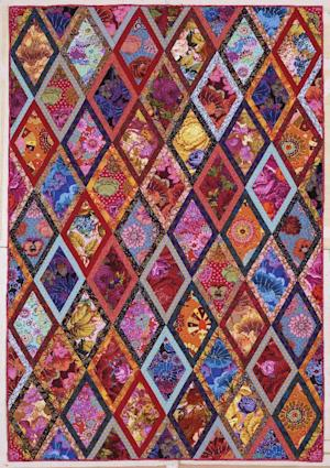 "This publicity photo provided by Abrams shows The Bordered Diamonds quilt from Kaffe Fassett's book ""Simple Shapes Spectacular Quilts"" (STC Craft/A Melanie Falick Book, 2010) and it also appears in his autobiography, ""Kaffe Fassett: Dreaming in Color"" (2012). He's taught workshops on this quilt throughout the world. (AP Photo/Abrams, Jon Stewart)"
