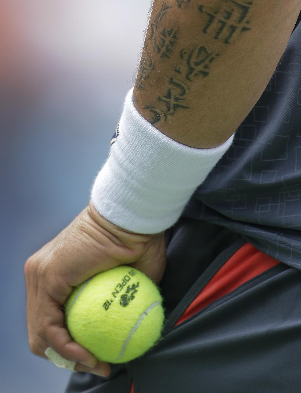 Janko Tipsarevic of Serbia grabs a ball from his pocket before serving against Spain's David Ferrer during the quarterfinals of the 2012 US Open tennis tournament, Thursday, Sept. 6, 2012, in New York. (AP Photo/Peter Morgan)