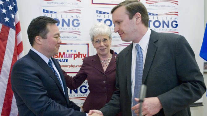 State Rep. William Tong, D-Stamford, left, shakes hands with U.S. Rep. Chris Murphy as Lt. Gov. Nancy Wyman, center, looks on after Tong announced he is dropping out of the race for U.S. Senate and endorsing Murphy, at a news conference at Goodwin College in East Hartford, Conn., Tuesday, May 1, 2012.  (AP Photo/Jessica Hill)