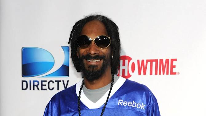 Snoop Dogg a.k.a. Snoop Lion arrives at DIRECTV's Seventh Annual Celebrity Beach Bowl, on Saturday, Feb. 2, 2013 in New Orleans. (Photo by Evan Agostini/Invision/AP)