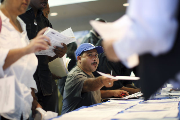 Job seekers fill out applications during the 11th annual Skid Row Career Fair at the Los Angeles Mission in Los Angeles