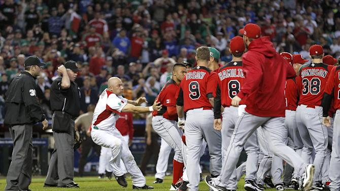 Players from Canada and Mexico fight during the ninth inning of a World Baseball Classic game, Saturday, March 9, 2013, in Phoenix. (AP Photo/Matt York)
