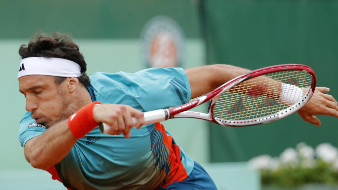 Argentina's Juan Monaco returns the ball to Spain's Rafael Nadal during their fourth round match in the French Open tennis tournament at the Roland Garros stadium in Paris, Monday, June 4, 2012. (AP Photo/Michel Euler)