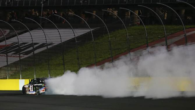 Kurt Busch (41) smokes after his engine blows up on the backstretch during the NASCAR Sprint Cup series Coca-Cola 600 auto race at Charlotte Motor Speedway in Concord, N.C., Sunday, May 25, 2014