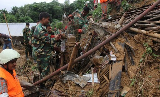 <p>Bangladeshi soldiers clear debris while searching for bodies after a landslide in Chittagong. More than 55 people have been killed in landslides in southeast Bangladesh after three days of rains that triggered flash floods and severed transport links, officials said Wednesday.</p>