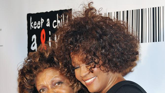 "FILE - In this Sept. 30, 2010 file photo, singers Cissy Houston, left, and her daughter Whitney Houston arrive at the ""Keep A Child Alive Black Ball"" at the Hammerstein Ballroom in New York. Houston says in her first interview since daughter Whitney's death that she's ""very proud"" of her and did the best she could raising her. Houston talked to My9 on Thursday night for an interview set to air Monday. The interview took place at New Hope Baptist Church in Newark, N.J., where Whitney first wowed a congregation as a girl and where her funeral was held Feb. 18. Houston says her daughter ""accomplished a whole lot in the short time that she had here"" and ""was a very wonderful person."" She says she doesn't blame herself for what happened to her because she knows she did the best she could. Whitney Houston, 48, died Feb. 11, in California. (AP Photo/Evan Agostini, file)"
