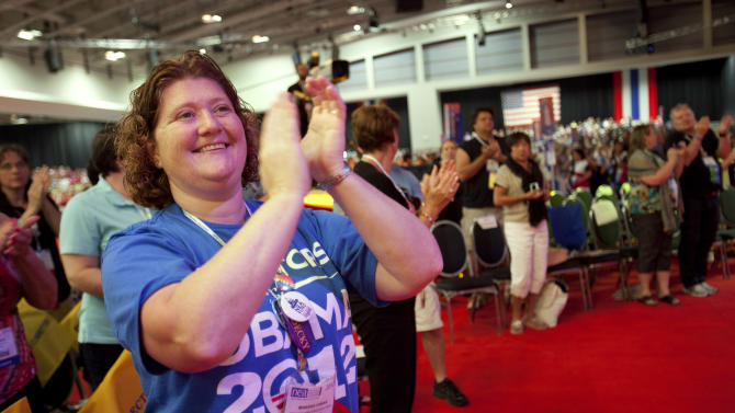 "Wearing a shirt that says ""Educators for Obama 2012,"" Marsha Fabian, a teacher, of Lancaster, Penn., claps during the National Education Association's annual convention in Washington, on Thursday, July 5, 2012. (AP Photo/Jacquelyn Martin)"