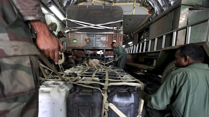 Plastic containers with drinking water is loaded into an Indian Air Force aircraft headed to Nepal, at an Indian Air Force base near New Delhi, India, Sunday, April 26, 2015. A strong magnitude-7.9 earthquake shook Nepal's capital and the densely populated Kathmandu Valley before noon Saturday, causing extensive damage with toppled walls and collapsed buildings, officials said.(AP Photo/Altaf Qadri)