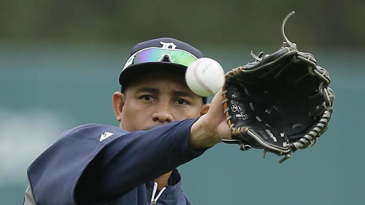 Detroit Tigers left fielder Ezequiel Carrera warms up before an interleague baseball game against the Colorado Rockies, Friday, Aug. 1, 2014, in Detroit. (AP Photo/Carlos Osorio)