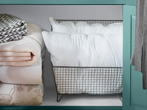 7. Designate a soft landing for spare pillows