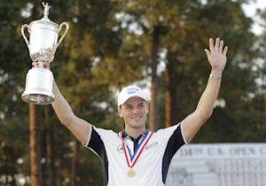 Martin Kaymer, of Germany, holds up the trophy after…