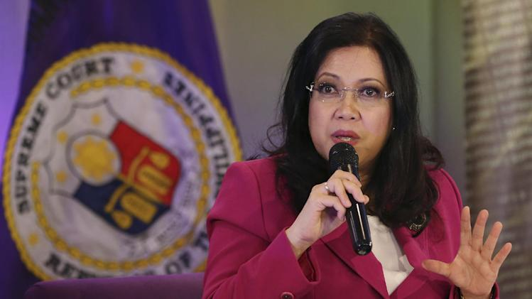 Philippine Supreme Court Chief Justice Maria Lourdes Sereno gestures while speaking to reporters in Manila, Philippines, Thursday, Aug. 28, 2014. Sereno refused to respond to President Benigno Aquino III's comments on Thursday or his previous criticisms of the court's June 30 ruling declaring his government's enforcement of a major economic stimulus program partly unconstitutional. Aquino said the Supreme Court meddles too much in political issues, reiterating his openness to amend the constitution to clip judiciary power. (AP Photo/Aaron Favila)