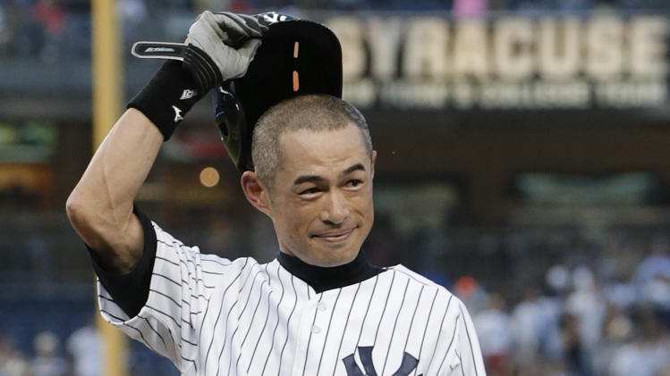 New York Yankees' Ichiro Suzuki tips his helmet to the crowd after connecting for his 4,000th career hit, in Japan and the major leagues combined, a first-inning single in a baseball game against the Toronto Blue Jays at Yankee Stadium, Wednesday, Aug. 21, 2013, in New York. (AP Photo/Kathy Willens)