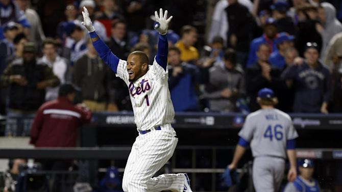 New York Mets' Jordany Valdespin (1) celebrates as Los Angeles Dodgers relief pitcher Josh Wall (46) retreats to the dugout after Valdespin hit a 10th-inning, walk-off grand slam to lift the Mets to a 7-3 win over the Dodgers in a baseball game at Citi Field in New York, Wednesday, April 24, 2013. (AP Photo/Kathy Willens)