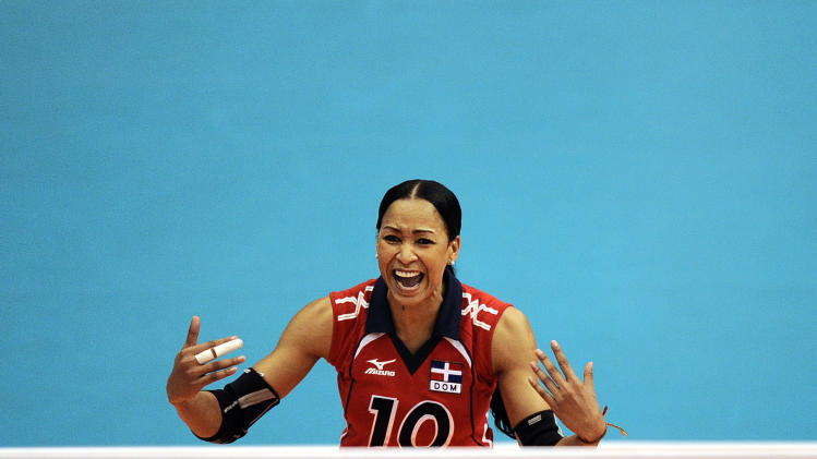 Milagros Cabral from Dominican Republic reacts during a women's volleyball semifinal match against Brazil at the Pan American Games in Guadalajara, Mexico, Wednesday, Oct. 19, 2011. Brazil won 3-0. (AP Photo/Daniel Ochoa de Olza)