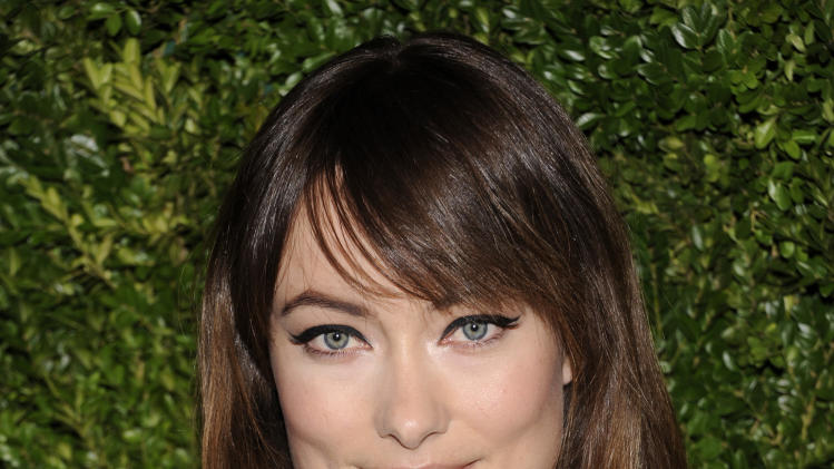 Actress Olivia Wilde attends the CFDA / Vogue Fashion Fund Awards at Skylight Soho on Monday, Nov. 14, 2011 in New York. (AP Photo/Evan Agostini)
