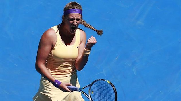 Victoria Azarenka of Belarus celebrates defeating Svetlana Kuznetsova of Russia in their women's singles quarter-final match at the Australian Open
