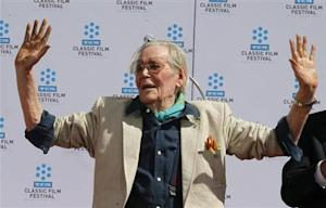 Irish-born actor Peter O'Toole displays his cement-covered hands after placing his handprints in cement during hand and footprint ceremonies honoring him at Grauman's Chinese Theatre in Hollywood