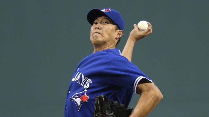 Toronto Blue Jays starting pitcher Chien-Ming Wang delivers to a Boston Red Sox batter during the first inning of a baseball game at Fenway Park, Thursday, June 27, 2013, in Boston. (AP Photo/Charles Krupa)