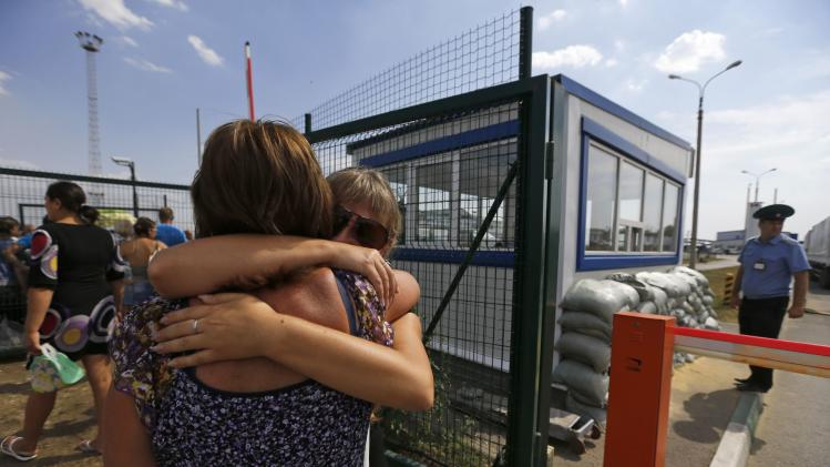 "Acquaintances embrace each other after meeting at Russia-Ukraine border crossing point ""Donetsk"" in Russia's Rostov Region"