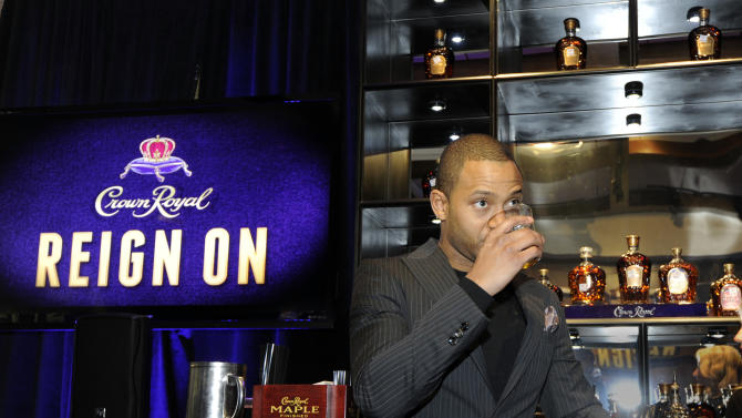 IMAGE DISTRIBUTED FOR CROWN ROYAL - Terrence J noses a glass of Crown Royal Extra Rare Whisky at the Crown Royal Reign On launch party during All-Star weekend on Saturday, Feb. 16, 2013, in Houston. Reign On is Crown Royal's new advertising campaign released this week. (Photo by Jack Dempsey/Invision for Crown Royal/AP Images)
