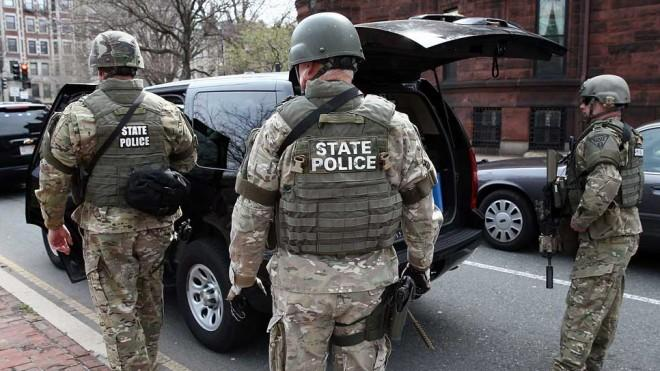 Massachusetts State Police guard an area near Kenmore Square after two bombs exploded during the 117th Boston Marathon on April 15.