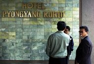 North Korean 'minders' responsible for the movement of visiting foreigners, are seen outside the Koryo Hotel in Pyongyang, in 2000. North Korea's notoriously harsh secret police consists of vast and sometimes competing agencies that will pose a major challenge to any potential attempts at reform, according to a study