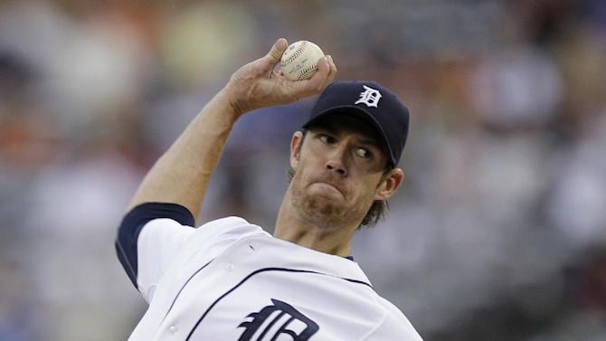 Detroit Tigers starting pitcher Doug Fister throws to the Kansas City Royals in the first inning of a baseball game in Detroit, Tuesday, Aug. 30, 2011. (AP Photo/Paul Sancya)