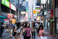 People are seen on a street in the city center of Seoul. South Korea&#39;s unemployment rate eased down in July from a month earlier due to an increase in new jobs, especially for the young, according to official figures
