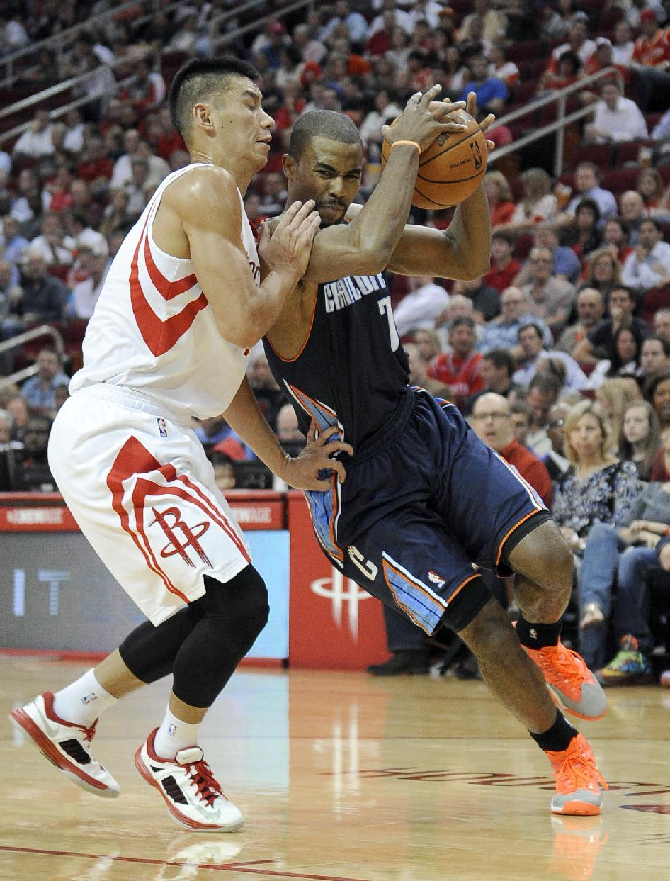 Howard leads Rockets over Bobcats 96-83 in opener