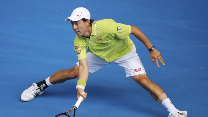 Nishikori of Japan hits a return to Wawrinka of Switzerland during their men's singles quarter-final match at the Australian Open 2015 tennis tournament in Melbourne