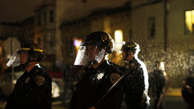 during a demonstration against the grand jury decision in the Ferguson, Missouri shooting of Michael Brown in San Francisco, California