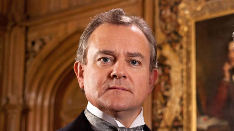 "This publicity image released by PBS shows Hugh Bonneville in a scene from the popular series ""Downton Abbey.""  Bonneville portrays the patriarchal Lord Grantham in the series, ""Downton Abbey.""  The season three finale airs Sunday, Feb., 17 on PBS. (AP Photo/PBS, Josh Barratt)"