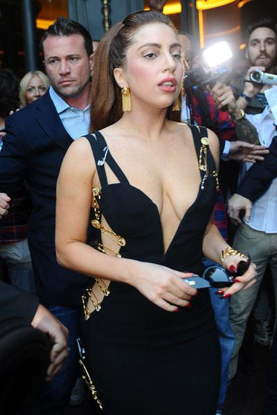 Despite getting criticism for her recent weight gain, Lady Gaga looks the picture of health while out and about in Milan. The controversial singer stepped back in time in an iconic safety pin Versace dress that was first made famous by Elizabeth Hurley in 1994. INFphoto.com