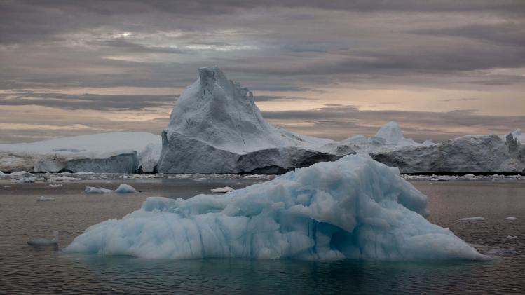 In this July 18, 2011 photo, icebergs shed from the Greenland ice sheet float near Ilulissat, Greenland. (AP Photo/Brennan Linsley)