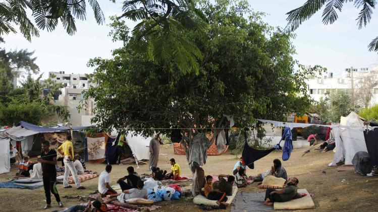 Palestinians seek shelter in the garden of the Shifa hospital in Gaza City
