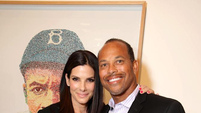 EXCLUSIVE CONTENT - PREMIUM RATES APPLY Sandra Bullock and Major League Baseball Scouting Bureaus' Darrell Miler at Artist Pat Riot's Art Exhibit, 'Out of Left Field' benefiting the MLB Urban Youth Academy on Thusday, May, 23rd, 2013 in Los Angeles. (Photo by Eric Charbonneau/Invision for Protagonist Brand Management/AP Images)