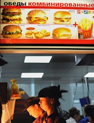 Employees serve clients in a McDonald&#39;s restaurant on Pushkin square in Moscow on February 1, 2010