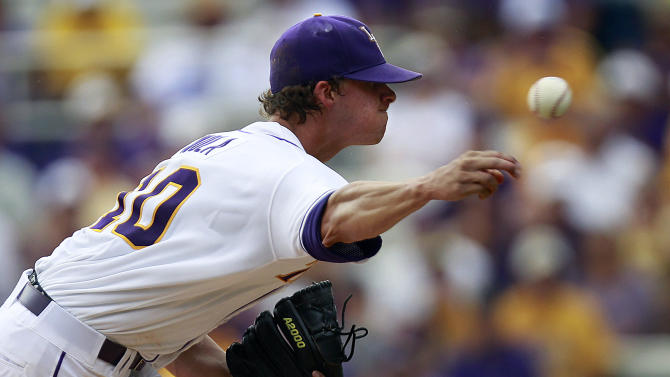 LSU pitcher Aaron Nola (10) pitches against Stony Brook in the first inning of an NCAA college baseball tournament super regional game in Baton Rouge, La., Friday, June 8, 2012. (AP Photo/Gerald Herbert)