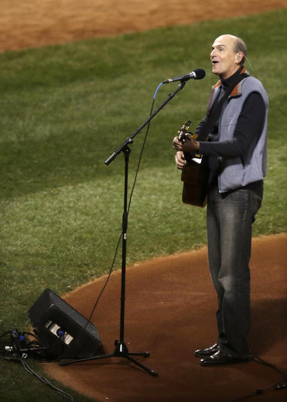 James Taylor sings the national anthem before Game 2 of baseball's World Series between the Boston Red Sox and the St. Louis Cardinals Thursday, Oct. 24, 2013, in Boston. (AP Photo/Charles Krupa)