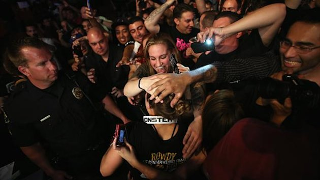 Ronda Rousey celebrates her UFC Bantamweight Title over Liz Carmouche with fans at Honda Center (AFP)