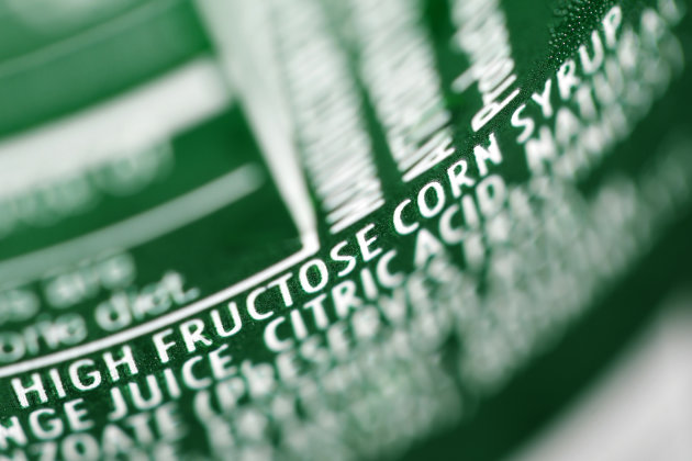 FILE - In this Sept. 15, 2011, file photo, high fructose corn syrup is listed as an ingredient on a can of soda in Philadelphia. Scientists have used imaging tests to show for the first time that fruc