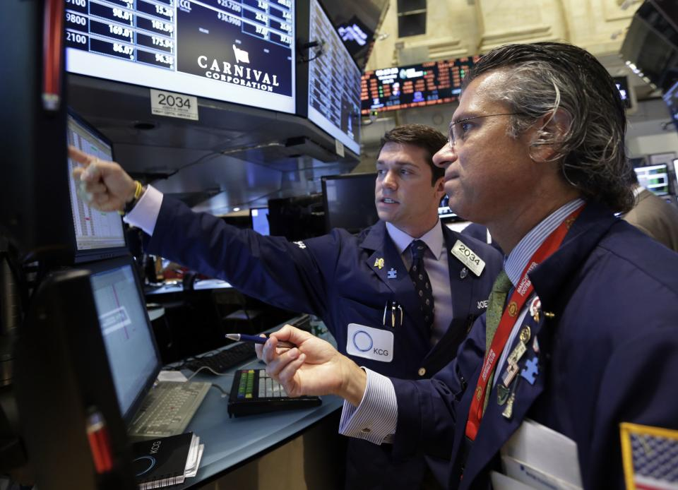 Miners, deal stocks, Apple rise on Wall Street