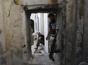 Free Syrian Army fighters rest in the old city of …