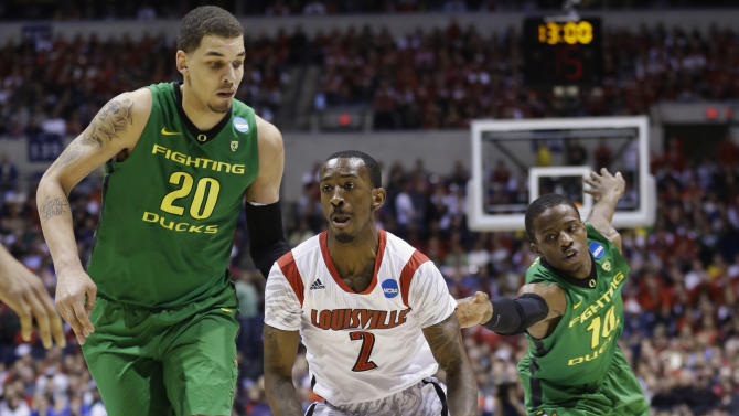 Louisville guard Russ Smith (2) drives against Oregon center Waverly Austin (20) and guard Johnathan Loyd (10) during the first half of a regional semifinal in the NCAA college basketball tournament, Friday, March 29, 2013, in Indianapolis. (AP Photo/Michael Conroy)