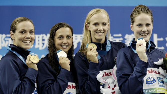 From right, U.S. team's Melissa Franklin, Dana Vollmer, Rebecca Soni and Natalie Coughlin show the gold medals they won in the women's 4x100Medley Relay final at the FINA 2011 Swimming World Championships in Shanghai, China, Saturday, July 30, 2011. (AP Photo/Michael Sohn)