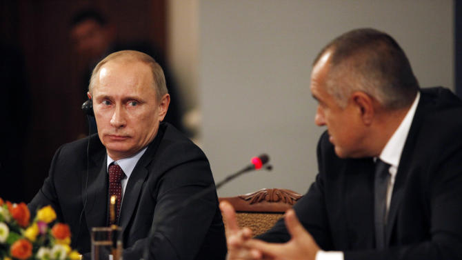 Russian Prime Minister Vladimir Putin, left, looks on as Bulgarian Prime Minister Boiko Borisov, right, speaks during a news conference after signing an agreement that will advance a pipeline project aimed at bringing Russian natural gas to central Europe and Italy, in Sofia, Saturday, Nov. 13, 2010. (AP Photo/Valentina Petrova)