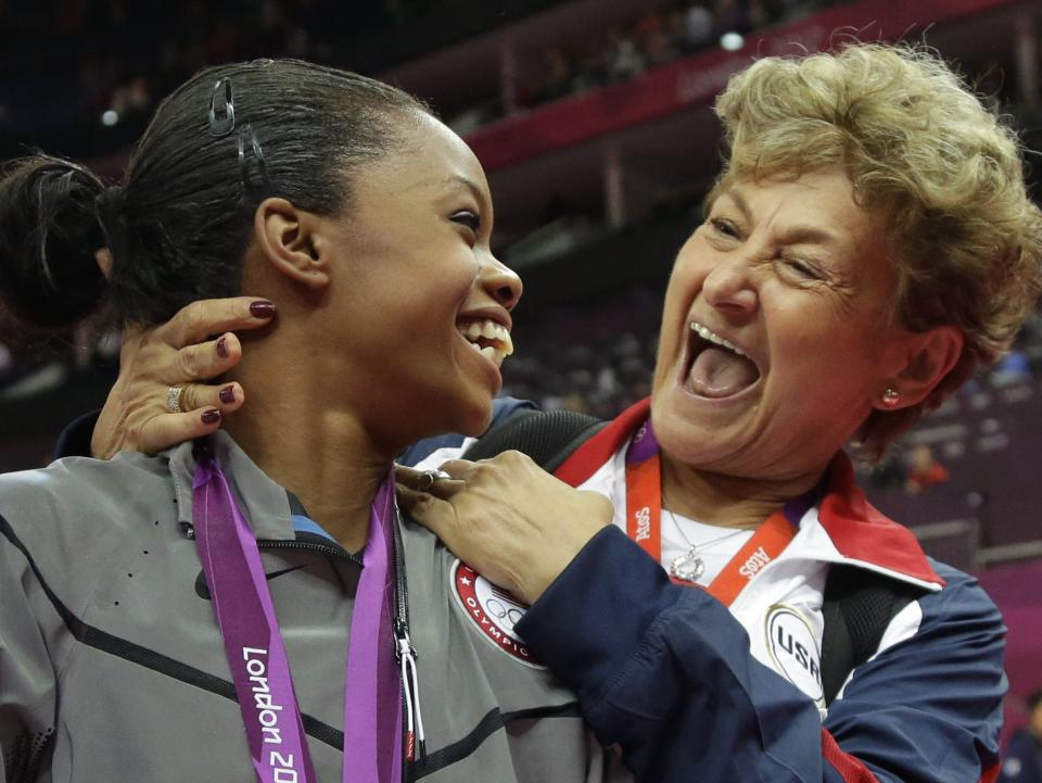 Marta Karolyi, U.S. national women's gymnastics team coordinator, right, hugs U.S. gymnast and gold medallist Gabrielle Douglas during the artistic gymnastics women's individual all-around competition at the 2012 Summer Olympics, Thursday, Aug. 2, 2012, in London.(AP Photo/Julie Jacobson)