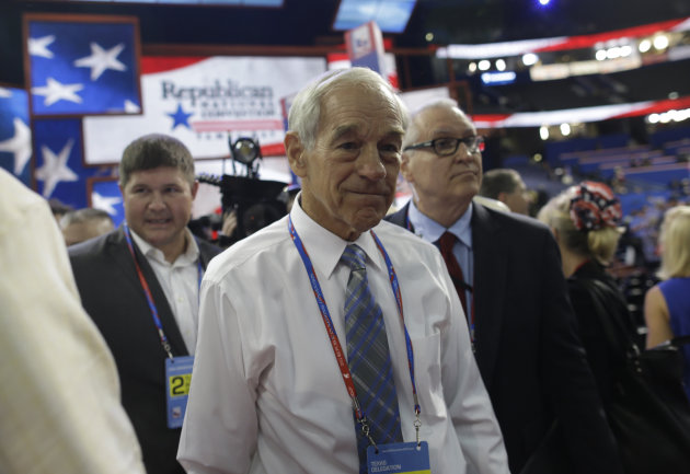 FILE - In this Aug. 28, 2012, file photo, Rep. Ron Paul, R-Texas, arrives on the floor at the Republican National Convention in Tampa, Fla. At least three Republican electors say they may not support their partys presidential ticket when the Electoral College meets in December to formally elect the new president. That prospect is escalating tensions within the GOP and adding a fresh layer of intrigue to the final weeks of the White House race. (AP Photo/Charles Dharapak, File)